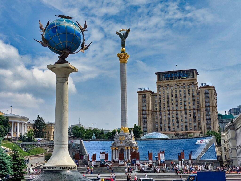 Independence Monument And Kilometer Zero Sign Maidan Square Kyiv